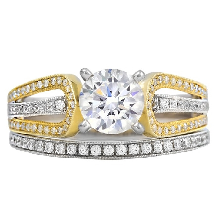 diamond engagement ring in 14 karat gold; white gold base; yellow gold double upper shanks with white gold between; all bead-set with 1/3cttw diamond; G-H/SI. Center 4 prong .83 H/SI2; optional band available separately