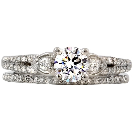 14 karat white gold diamond engagement ring; narrow split raised shoulder shank with pear-shaped panel at top; triangular panel below prongs on side view; all diamond-set with a total weight of  1/4 carat GH/I1; 4 prong center setting holds a round b