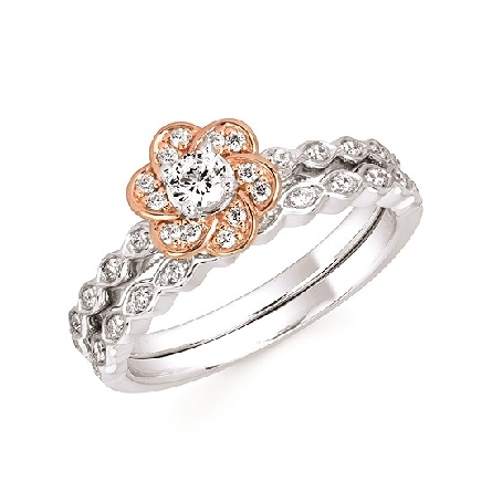 10 karat gold engagement ring; white gold shank has diamonds set in marquise shaped panels; four prong head holds a .14 carat diamond; rose gold scalloped halo set with diamonds; .27cttw GH/SI. Shown with optional wedding band.