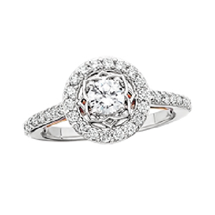 14 karat two tone diamond ring; white gold base with rose gold filigree under the top; .40 carat center surrounded by fiigree then a halo; diamonds on shanks; surprise diamonds in the rose gold. Trim diamonds=.60cttw. All are GH/SI.
