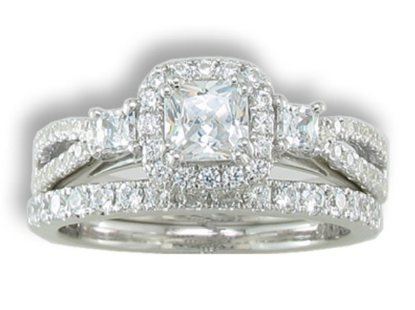 14 karat white gold diamond ring; center is .75 carat F/VS1 princess cut with halo; diamond at the top of each diamond-set pinch top split shank. Mounting has 3/4 carat total weight GH/SI. Shown with optional wedding band.