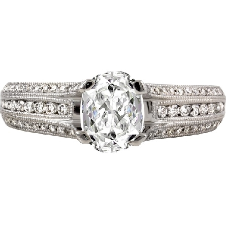 14 karat white gold diamond ring; .83 carat D/VS1 radiant center; three rows pave-set on the shanks; with the outer rows extending up to form the four prongs. Semi mount has 3/8cttw GH/SI. Shown with oval center.