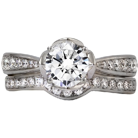 14 karat white gold diamond ring; center is a modified brilliant (square octagon) .71 carat H/SI1 with open peatals from base of top to near flat sides of diamond; pinch top shank with graduated sizes diamond; diamonds around base of center setting.