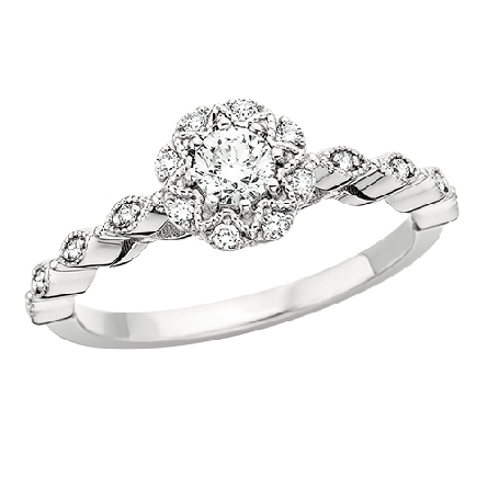 14 karat white gold diamond engagement ring; 1/4 carat round center; 1/3cttw including flower shaped halo and diamonds in shank panels; milgrain trim; raised center; all diamonds are GH/SI