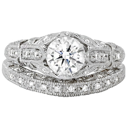 14 karat white gold semi-mount diamond ring; vintage filigree and milgrain   petals   form integral prongs; 6.5mm soft-set CZ in center. Shown with optional wedding band.