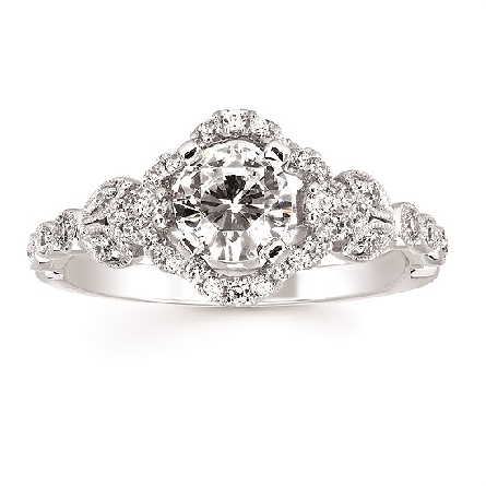 14 karat white gold engagement ring semi-mount; four-prong center holds a 6mm (.80 carat diamond size); shaped halo with milgrain edged shapes on the side shanks; surprise diamond under both sides; .29cttw GH/SI