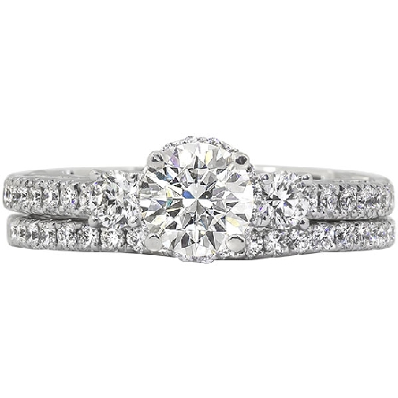 14 karat white gold semi-mount diamond ring; center 4-prong holds a soft-set 5mm (half carat size) cubic zirconia; diamond halo; larger diamonds at the top of the shanks; shared-prong-set diamonds on the shank; scallop design and surprise diamonds un