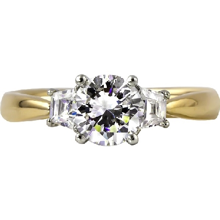 14 karat yellow gold semi-mount ring; polished cathedral shank with three white gold four-prong settings; center is a soft-set one carat size round cubic zirconia; side stones are 1/4cttw trapezoid shaped diamonds GH/SI