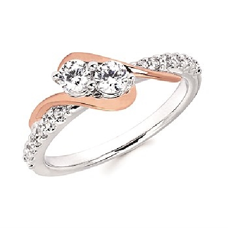 14 karat diamond ring; white gold straight shank with bead set mellee; two prong-set centers set on the diagonal with a rose gold swirl on each side; I/I1; 2@.16ct.; 4@.0125; 10@.01