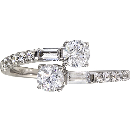 14 karat white gold diamond ring; 2=.76ct GH/SI1 at ends of bypass shanks with baguette beside; followed by full-cut rounds halfway around shank; trim=1/3cttw GH/I1