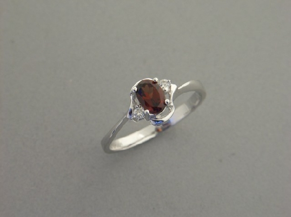 14 karat white gold ring set with oval garnet weighing .57ct. inside an open swirl top; with one diamond on each side weighing .04cttw.