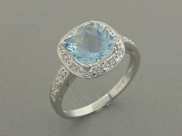 14 karat white gold ring; 8mm checkerboard-cut cushion shaped prong-set aquamarine (1.91 carat) surrounded by diamonds; diamonds down the top of the straight side shanks (.14cttw)