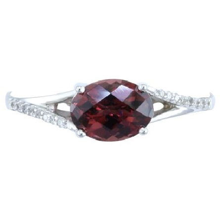 14 karat white gold ring; oval checkerboard cut rhodolite garnet (1.44 carat) set east-west; split shank with diamonds on opposite edges (.07cttw)