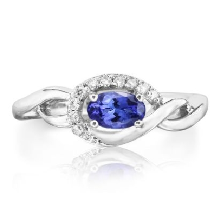 14 karat white gold ring; oval tanzanite (.45 carat) set east west inside open frame with diamonds (.09cttw H-I/SI2) curving under  and around one side; twist shank