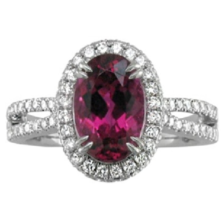 14 karat white gold ring; oval rubellite (red tourmaline) center measures approx. 10x7mm; weighs 2.23 carat; halo with diamonds on top and sides; diamond collar underneath; cathedral pinch-top split shank set with diamonds; .63cttw; G-H/SI