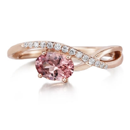 14 karat rose gold ring; oval Lotus garnet in 4 prong setting weighs .94 carat; split shank on one side becomes single row of bead-set diamonds; .09cttw H/SI2