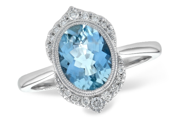 14 karat white gold ring; oval aquamarine (1.56 carat) with milgrain bezel; diamonds above and below in vintage pattern (.14cttw)