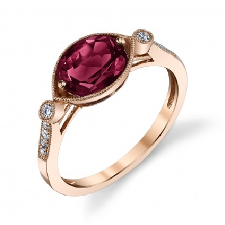 14 karat rose gold ring; oval checkerboard-cut rhodolite garnet set east-west; app.1.41ct; bezel-set diamond on each side; diamonds down shanks; .10cttw; milgrain trim on all
