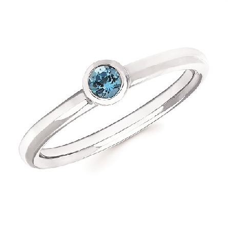 10 karat white gold stackable ring with bezel set round blue topaz