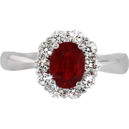 18 karat white gold ring; 5.4x7.6mm 1.51 carat oval ruby surrounded by 10 diamonds; with a diamond at the palmside of a pinch-top euro shank; .55cttw FG/VS
