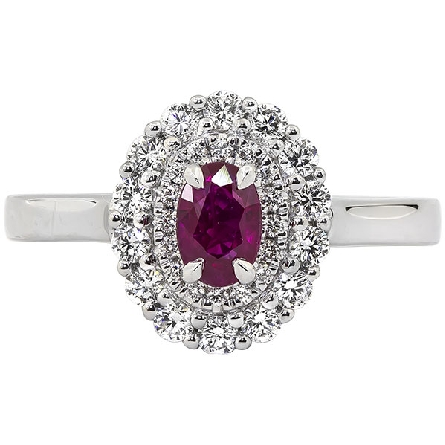14 karat white gold ring with a .63 carat oval ruby; double halo of diamonds with a total weight of .49 carat (GH/SI); beaded filigree underbezel and inside shank trim