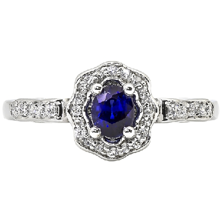 14 karat white gold ring with oval star-grade sapphire surrounded by a flluted halo set with diamond; diamonds on shank; 3/16cttw GH/SI
