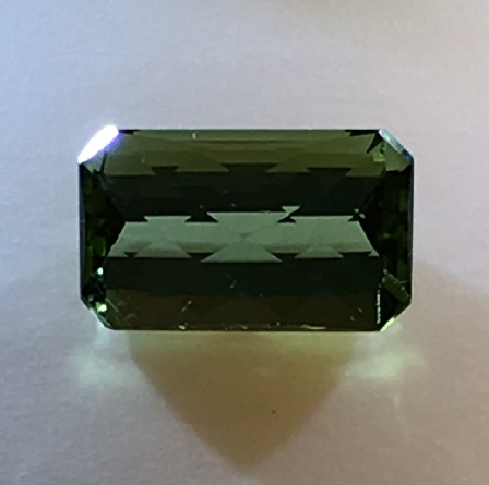 loose tourmaline; 11.5x7mm octagon cut with checkerboard top weighing 3.65 carats. Cut in the Idar-Oberstein region of Germany. We d like to help you design your new favorite piece of jewelry around this gem!