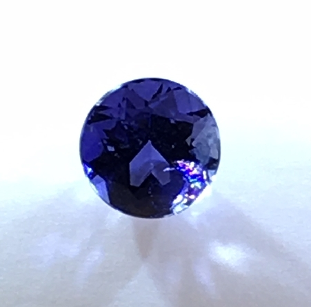 loose iolite; 7mm round weighing 1.19 carat; with a color that rivals the best tanzanite at a fraction of the cost. Cut in the Idar-Oberstein region of Germany. We d like to help you design your new favorite piece of jewelry around this gem!