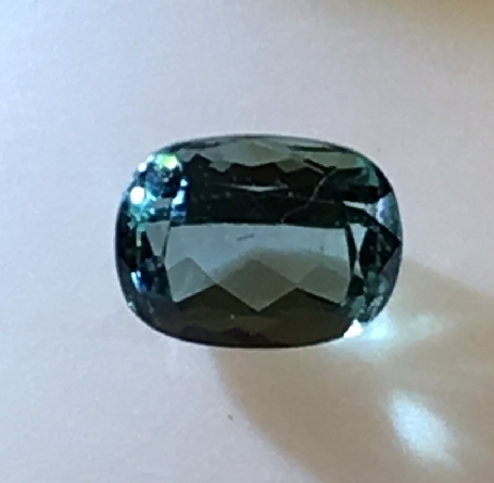 loose tourmaline; 9x7mm antique cushion cut weighing 2.50 carat; a beautiful blue-green. We d like to help you design your new favorite piece of jewelry around this gem!