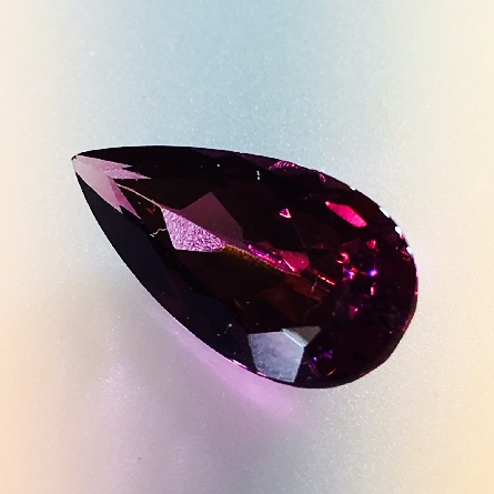 loose pear-shape rhodolite garnet; 2.97 carats; gorgeous long teardrop measuring over 13x6mm. Pendant; anyone?