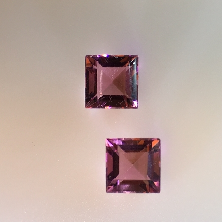 adorable pair of loose pink tourmalines; 5mm square step-cut; total weight 1.29 carat. Earrings; of course; or as accents to a larger stone.