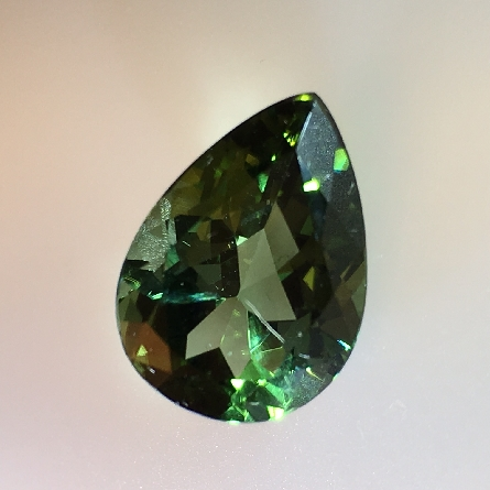loose tourmaline; a huge 14x10mm pear shape; weighing 5.12 carats! How would you set it?