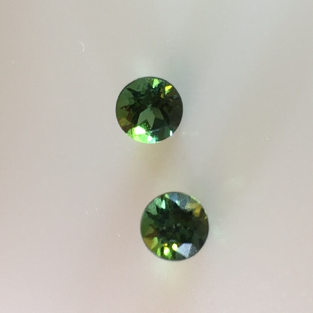 pair of loose green tourmalines measuring 4.5mm; with a total weight of .75 carat. The obvious choice for these cuties would be earrings; but why not combine them with any one of a number of coordinating gems available on this site?