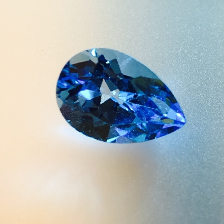 loose 9x6mm pear-shaped Swiss blue topaz weighing 1.8 carat. Simple and inexpensive.