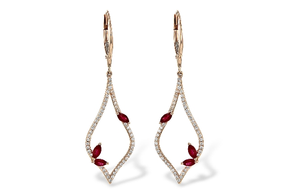14 karat rose gold lever back earrings; elongated open shape with point at top and bottom and rounded sides; diamonds set all around frame; two navette rubies set on one side near bottom; one more navette ruby closer to top on other side. Diamonds=.3
