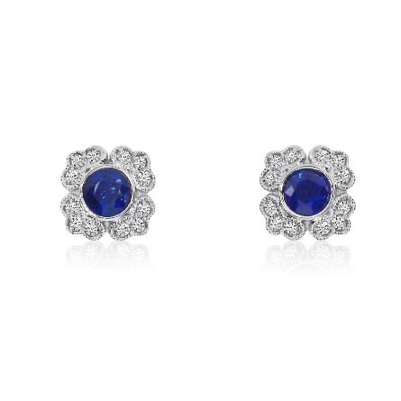 14 karat white gold earrings with milgrain trim; centerpiece is a round blue sapphire surrounded by vintage-look diamond panels; .14cttw diamond; .50cttw sapphire