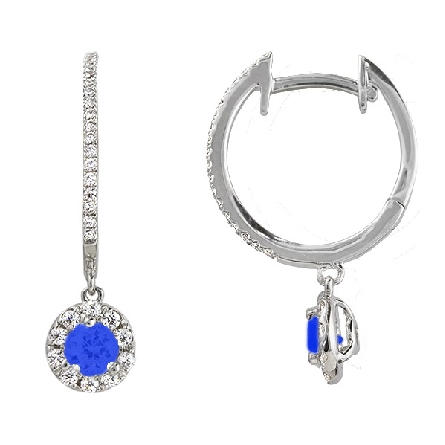 14 karat white gold hoop earrings; diamonds set along the front; dangle at the bottom has a 4mm round star grade sapphire and diamond halo (1/3cttw HI/I1); hinged on the back