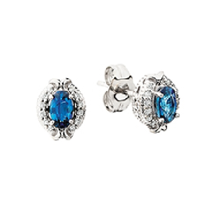 14 karat white gold earrings with an oval center sapphire; .10cttw diamond halo with decorative polished trim at top and bottom; filigree and milgrain framework under the gems