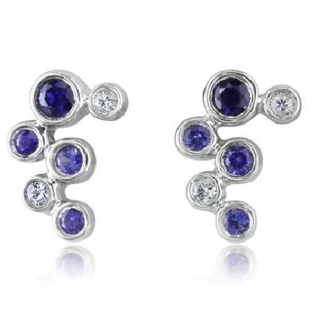 14 karat white gold earrings on friction posts with offset bezel-set sapphires in graduated shades of blue to white