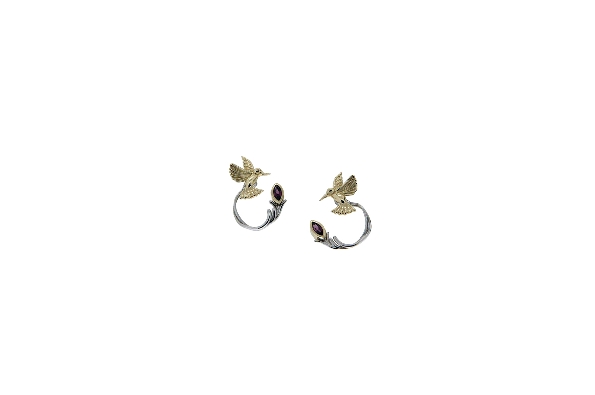 These earrings are part of Keith Jack s Celtic-inspired Hummingbird Collection. The hummingbird studs are made of 10 karat yellow gold; and the jackets are sterling silver with rhodolite garnet. The jackets can be worn either on the front or the back