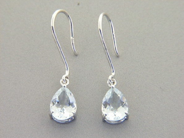 14 karat white gold French wire earrings with a dangle of 8x6mm pear shaped aquamarine; 1.82cttw