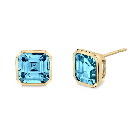 14 karat yellow gold blue topaz stud earrings; octagonal step-cut bezel-set; 1.65cttw