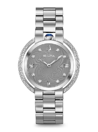 Woman's Bulova watch from the Rubaiyat Collection. Legendary heritage reinvented in stainless steel case with synthetic blue spinel cabochon crown at 12:00 and 50 diamonds individually hand set on case parenthesis and textured grey dial; double curve