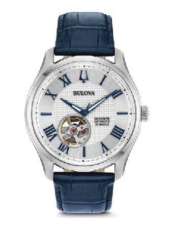 Man s Bulova watach; stainless steel screw-back case; textured silver white three-hand dial with blue Roman numerals/markers and round dial aperture offering a glimpse of the self-winding 21-jewel heartbeat movement with 60 hours of reserve power; do