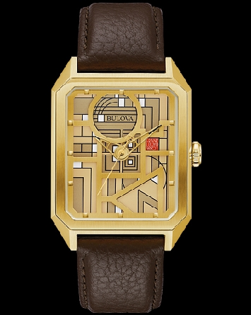 Marking the 80th anniversary of the Frank Lloyd Wright Foundation; this numbered edition timepiece from Bulova; number 271/500; was adapted from the December Gifts design. featuring a gold-tone stainless steel case and a stitched brown leather pebble