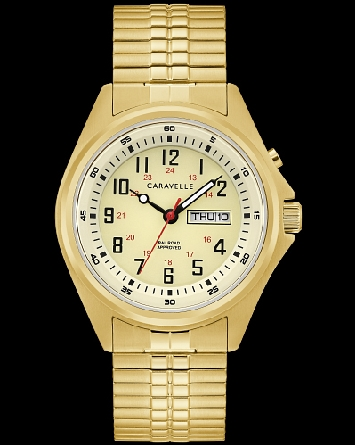 Caravelle watch by Bulova has a backlit feature that illuminates the dial and is activated with a pusher at 2 o'clock. Goldtone stainless steel case with a full Arabic parchment colored dial also features a military time inner track; day/date window;