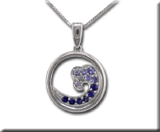 14 karat white gold pendant; open circle with ocean wave shape set with graduated shades of blue sapphires