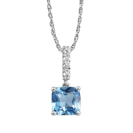 14 karat white gold pendant with a row of diamonds (.06cttw) on the bail leading to a dangling cushion shaped blue topaz (1.14ct); on rope chain