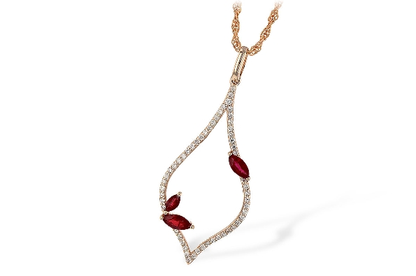 14 karat rose gold pendant; elongated open shape with point at top and bottom and rounded sides; diamonds set all around frame; two navette rubies set on one side near bottom; one more navette ruby closer to top on other side; with single bail on rop