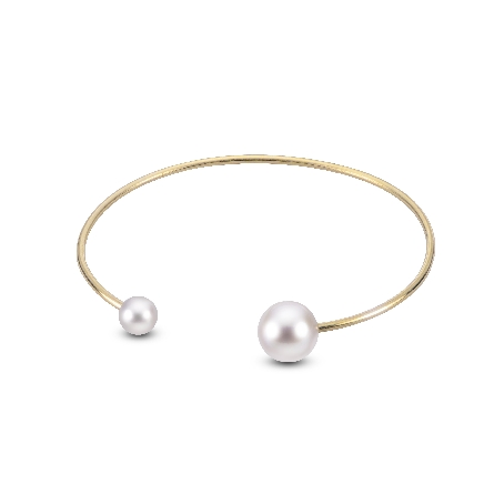 14 karat solid wire cuff bracelet with a freshwater pearl on each end; one each 6-6.5mm and 9-9.5mm